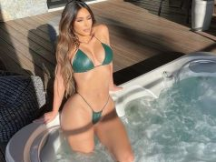 Kim Kardashian stuns in a green leather bikini